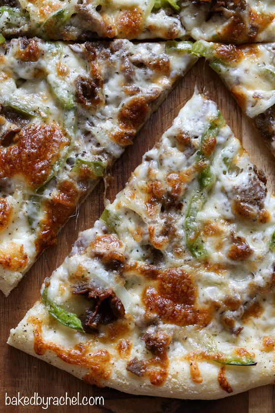 Three cheese thin crust cheesesteak pizza with green peppers and onions. Recipe from @bakedbyrachel