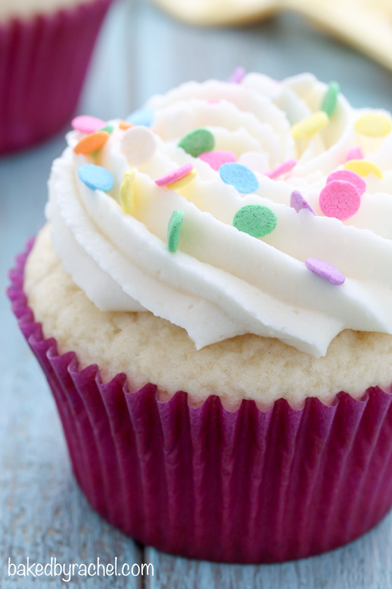 Moist white cupcakes with silky vanilla buttercream frosting recipe from @bakedbyrachel.  Perfect for birthdays and celebrations of all kinds!