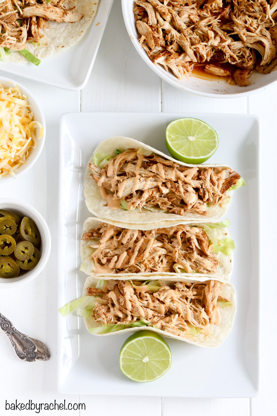 Easy slow cooker chicken tacos with spicy chipotle sour cream sauce recipe from @bakedbyrachel