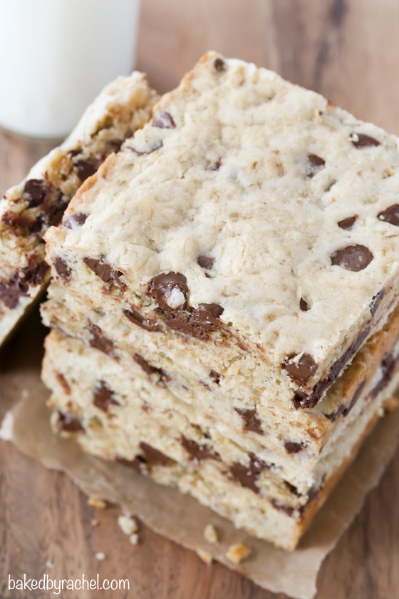 Soft and chewy oatmeal chocolate chip cookie bar recipe from @bakedbyrachel