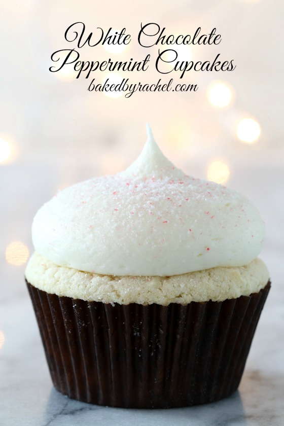 Moist homemade white chocolate cupcakes with white chocolate peppermint cream cheese frosting recipe from @bakedbyrachel