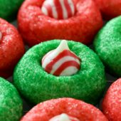Soft and fluffy candy cane peppermint kiss cookie recipe from @bakedbyrachel A peanut-free twist on a classic cookie and a fun addition to any holiday cookie tray!
