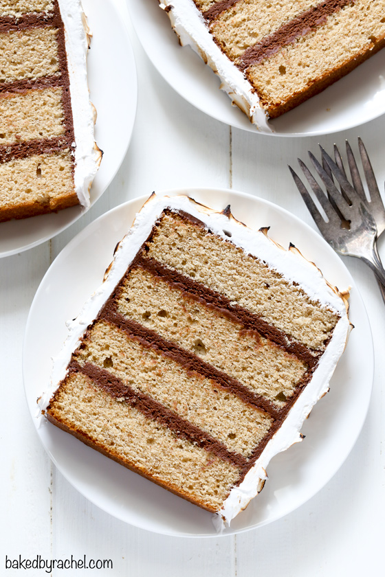 Layers of cinnamon graham cake with chocolate buttercream filling and coated in toasted marshmallow frosting.