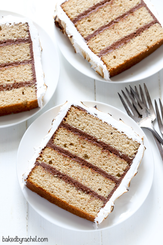 Layers of cinnamon graham cake with chocolate buttercream filling and coated in toasted marshmallow frosting