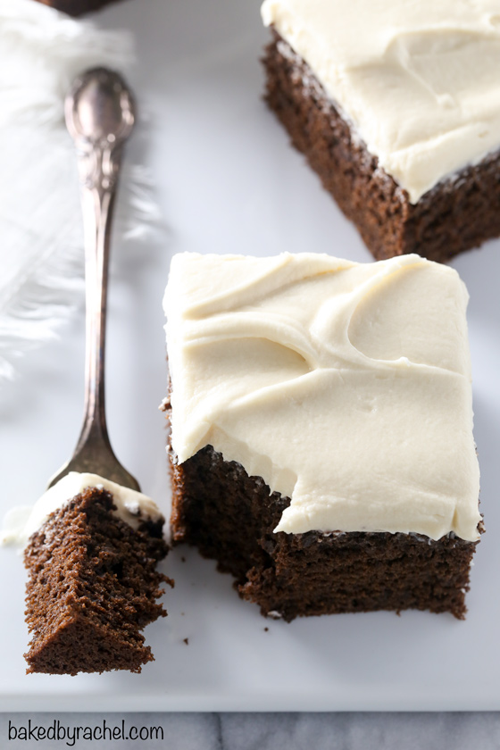 Moist and fluffy Guinness chocolate cake with silky brown sugar cream cheese frosting recipe from @bakedbyrachel A crowd pleasing dessert, perfect for St. Patrick's day or any day of the year!